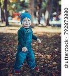 child walking in the park. | Shutterstock . vector #792873880