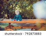 child walking in the park. | Shutterstock . vector #792873883