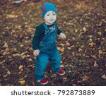 child walking in the park. | Shutterstock . vector #792873889