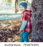 child walking in the park.   Shutterstock . vector #792874393