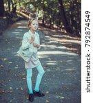 child walking in the park.   Shutterstock . vector #792874549