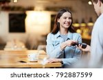 young smiling woman with card... | Shutterstock . vector #792887599