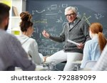 friendly teacher talking to his ... | Shutterstock . vector #792889099