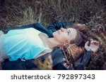 a beautiful girl is resting on... | Shutterstock . vector #792897343