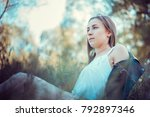 a beautiful girl is resting on... | Shutterstock . vector #792897346