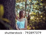 a beautiful girl is resting on... | Shutterstock . vector #792897379