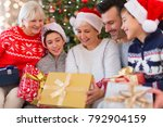 family with christmas presents | Shutterstock . vector #792904159