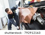 car wrapping specialist putting ... | Shutterstock . vector #792912163
