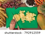 hands cutting pineapple ... | Shutterstock . vector #792912559