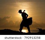 silhouette of a salt farmer... | Shutterstock . vector #792913258
