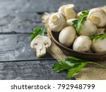 fresh mushrooms in a clay bowl... | Shutterstock . vector #792948799