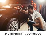 a man cleaning car with... | Shutterstock . vector #792985903