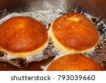 traditional donuts frying in... | Shutterstock . vector #793039660