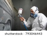 painter spray gun in the hands... | Shutterstock . vector #793046443