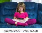 little girl sitting and play... | Shutterstock . vector #793046668
