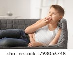 overweight boy eating donut at... | Shutterstock . vector #793056748