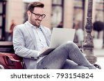 smiling businessman sitting on... | Shutterstock . vector #793154824