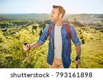 smiling man hiking in the... | Shutterstock . vector #793161898
