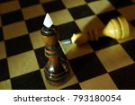 Small photo of Chess king won adversary. Victory and defeat. Concept with wooden chess pieces