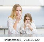 little girl and woman drink... | Shutterstock . vector #793180120