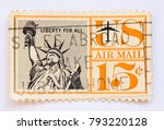 Small photo of United States of Ameria - 1961 - US airmail 15c postage stamp shows the Statue of Liberty and the quote Liberty for All