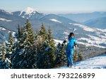 female skier standing on top of ... | Shutterstock . vector #793226899