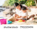 asian mother and baby play sand ... | Shutterstock . vector #793235494