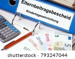 Small photo of File folder with the german words parental contribution notice and Child day care facility