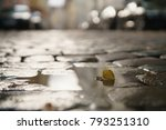 wet old pavement with puddle... | Shutterstock . vector #793251310