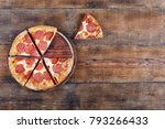 pepperone pizza cut into pieces ...   Shutterstock . vector #793266433