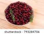 Small photo of Cranberries in wicked plate. Organic berries