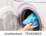woman loading laundry to the... | Shutterstock . vector #793324810