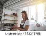female artisan standing alone... | Shutterstock . vector #793346758