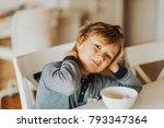 cute little boy eating his... | Shutterstock . vector #793347364