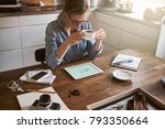 young woman sitting at her... | Shutterstock . vector #793350664