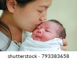 closeup mother kissing infant... | Shutterstock . vector #793383658