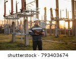 the energy engineer inspects... | Shutterstock . vector #793403674