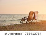 deck chairs with towels on... | Shutterstock . vector #793413784
