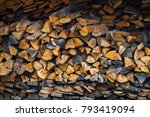 roughly stacked firewood | Shutterstock . vector #793419094