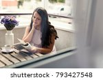 pretty girl reading a book on... | Shutterstock . vector #793427548