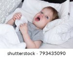 sick child boy laying in bed... | Shutterstock . vector #793435090