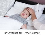 sick child boy laying in bed... | Shutterstock . vector #793435984