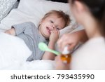 sick child concept. mother... | Shutterstock . vector #793435990
