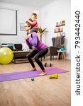 young mother in sportswear... | Shutterstock . vector #793442440