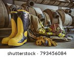 firefighter boots and fire hoses | Shutterstock . vector #793456084
