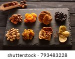 dried fruits and nuts on slate... | Shutterstock . vector #793483228