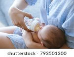 feeding the newborn with a... | Shutterstock . vector #793501300