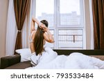 woman stretches on the bed... | Shutterstock . vector #793533484