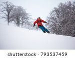 a skier is riding downhill in... | Shutterstock . vector #793537459