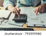 business woman using calculator ...   Shutterstock . vector #793595980